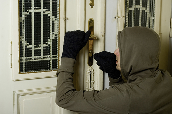burglar-breaking-into-unsecured-home