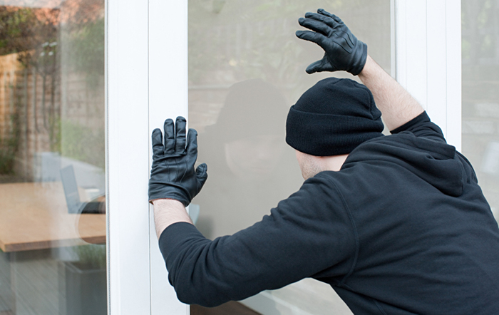 burglar-looking-for-alarm-system