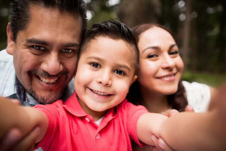 family-smiling-with-child
