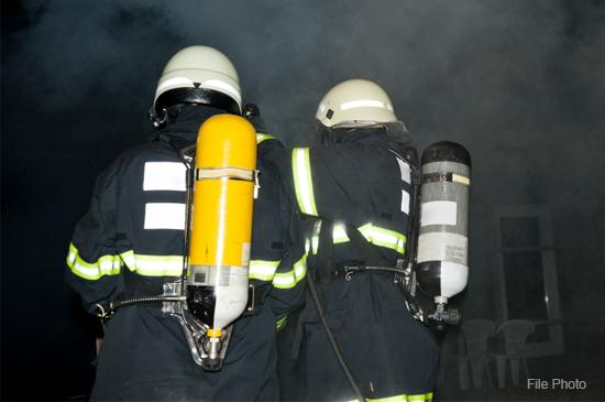 firemen-extinguish-home-fire