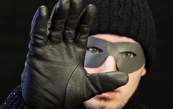 masked-home-burglar-hand-raised