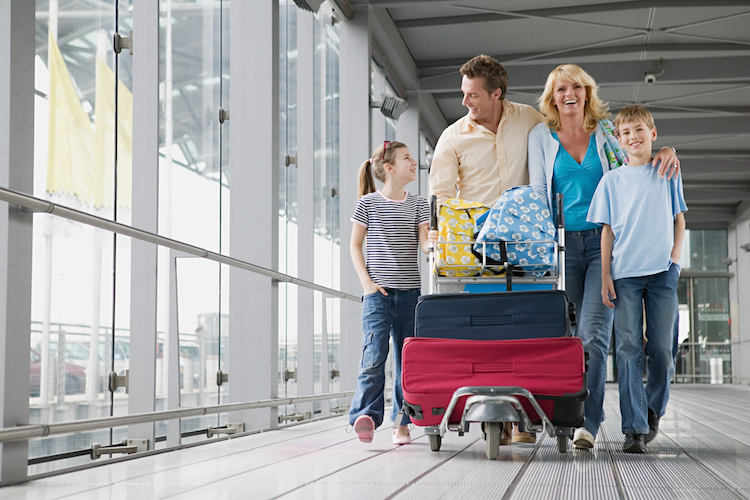 family-traveling-with-suitcases